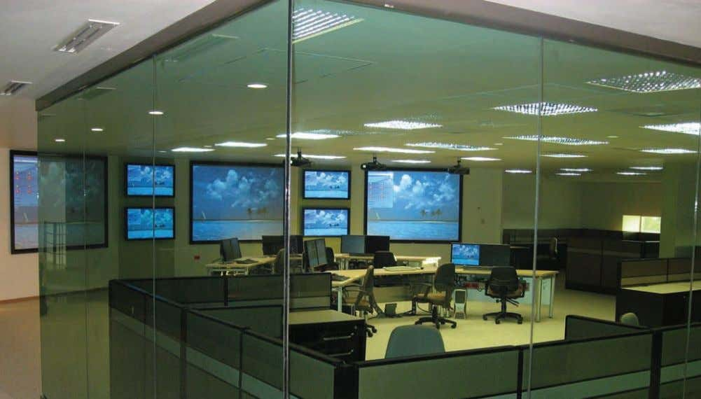 "Fig. 6—Kongsberg Maritime real-time operations center. 2004) (Fig. 5). ""The system can pro- vide information"