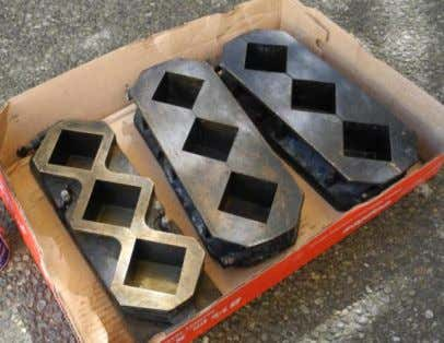 at a lower strength. Figure 4: Plastic cube molds (capped) Figure 5: Brass molds While the