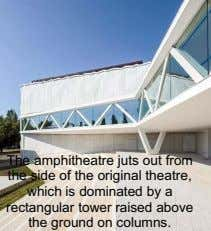 The amphitheatre juts out from the side of the original theatre, which is dominated by