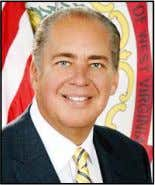 Charleston, W.Va.: Gov. Earl Ray Tomblin, a Democrat, narrowly won a special elec- tion for governor