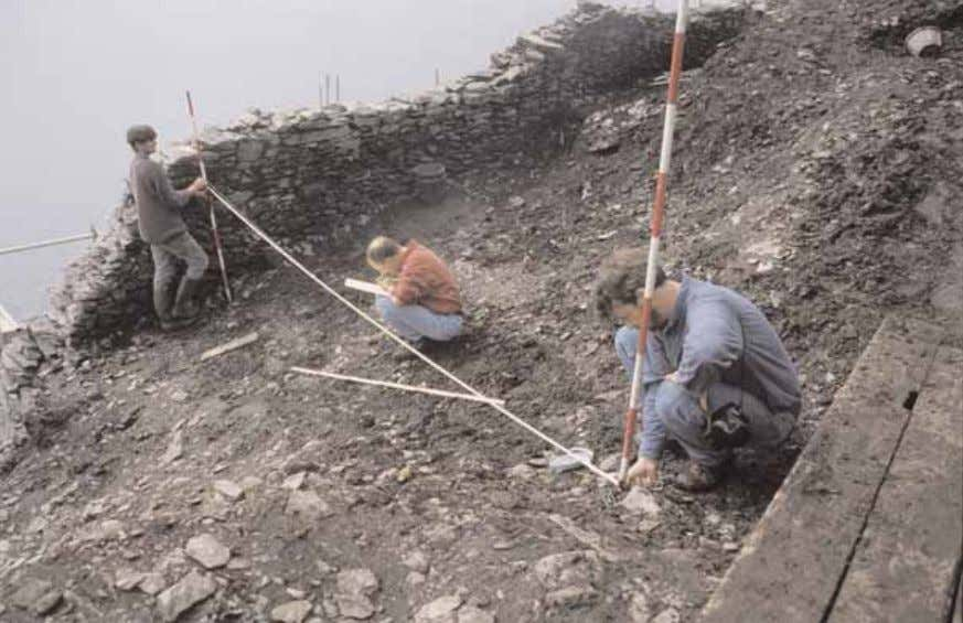 have been used to record the features after excavation. Pl. 16 - Survey work on the