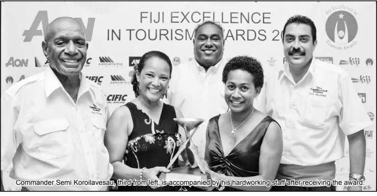 Commander Semi Koroilavesau, third from left, is accompanied by his hardworking staff after receiving the award.