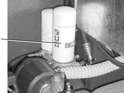 requires the removal of the right top panel. Fig. 12 1 F 1. Oil separator cartridge