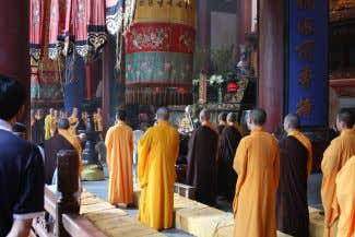 ten precepts , which are the basic precepts for monastics. Buddhist monk s performing a ceremony