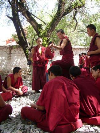 by the three marks of existence . Three Marks of Existence Monks debating at Sera Monastery