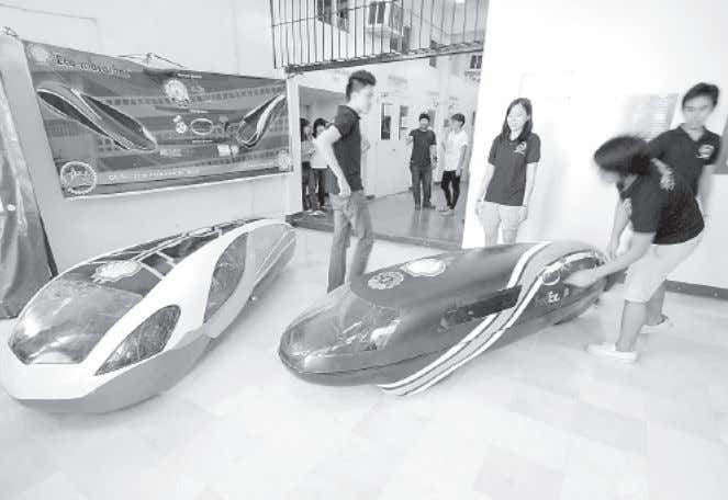 Vehicles of the future. Students of De La Salle University check the eco-marathon cars which