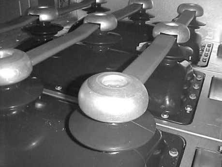 cap with two cutouts fo r middle cubicles (upside down). Figure 3.27 Aluminum field control caps.