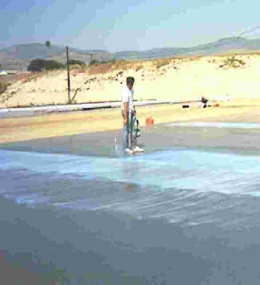Water is being sprinkled to prevent lost of moisture from the surface of curing concrete.
