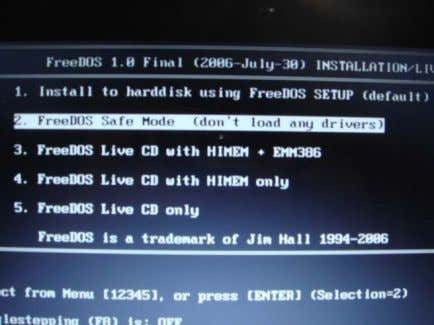 "select ""FreeDOS Safe Mode (don't load any drivers)"" 5. Execute the batch file Flash.BAT and press"