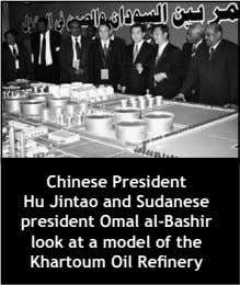 Chinese President Hu Jintao and Sudanese president Omal al-Bashir look at a model of the