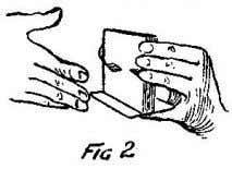 the card to be changed—is covered only once by the hand. The pack is held in