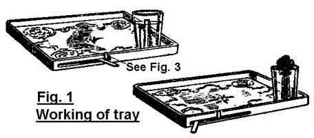 and the real bottom of the tray. When we remove the false bottom we see a