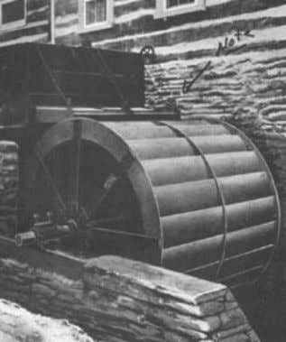 in Fig. 1a. No water is carried over the lowermost point. a. Overshot cell wheel, USA