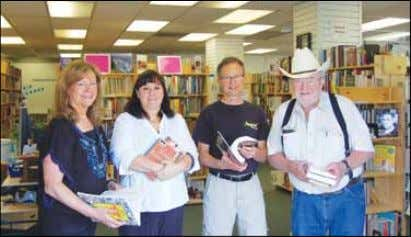to its current location through a special lease agreement Rogue Book Exchange volunteers, l-r: Jan Martin,