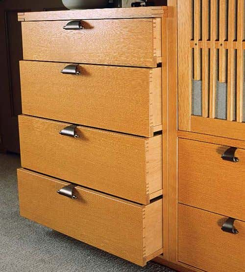 Hand-cut joints and handmade pulls from India. All of the drawers have variably spaced, hand-cut dovetails.