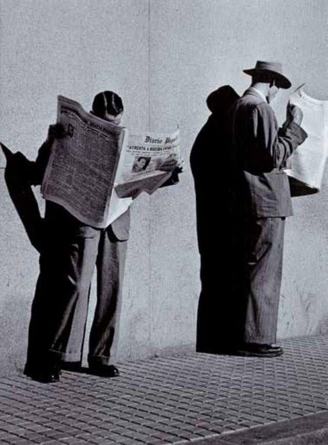a photographer in the 1940s, captures here the image of two men reading a job advertisement