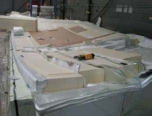 of the top layer on foam block at Holland Composites. Figure 34. Inserts to be placed
