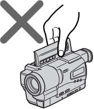 camcorder by holding the lid of the cassette compartment. To prevent accidental erasure Slide the write-protect