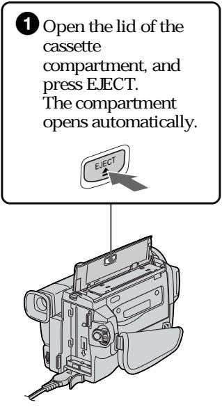 1 Open the lid of the cassette compartment, and press EJECT. The compartment opens automatically.
