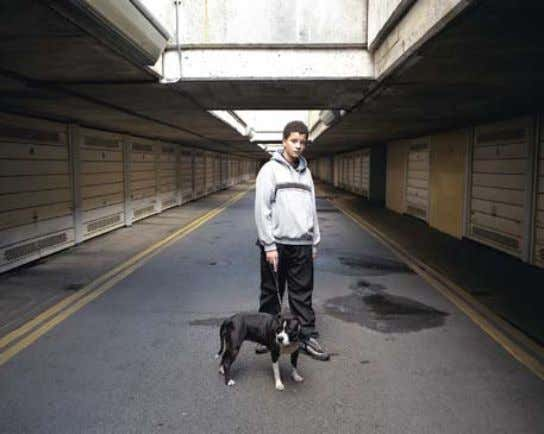 iLan godfreY United Kingdom Alexandria and Ainsworth Estate : Camren, 13, With His Dog Bonnie : From the series