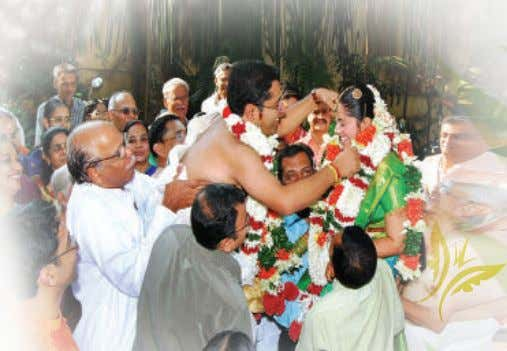and the groom on their shoulders and the bride and groom exchange garlands three times. This