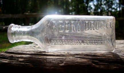 as evidenced by the city directory and advertisements. ! ! Bottles released by Peery were embossed