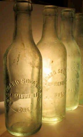 "been found in local dumps. The bottles have crown tops and are embossed ""Standard Soda Works"