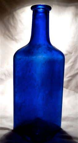 Below: This circa 1910 cobalt barber bottle likely contained shampoo. It was recovered in a McMinnville