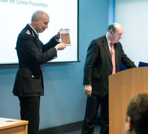 Launched by Norman Baker MP (Minister for Crime Prevention) The first copy being handed over to