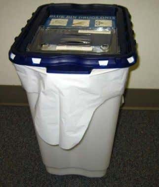 in the soiled laundry room of each unit. • These bins are secured in place and