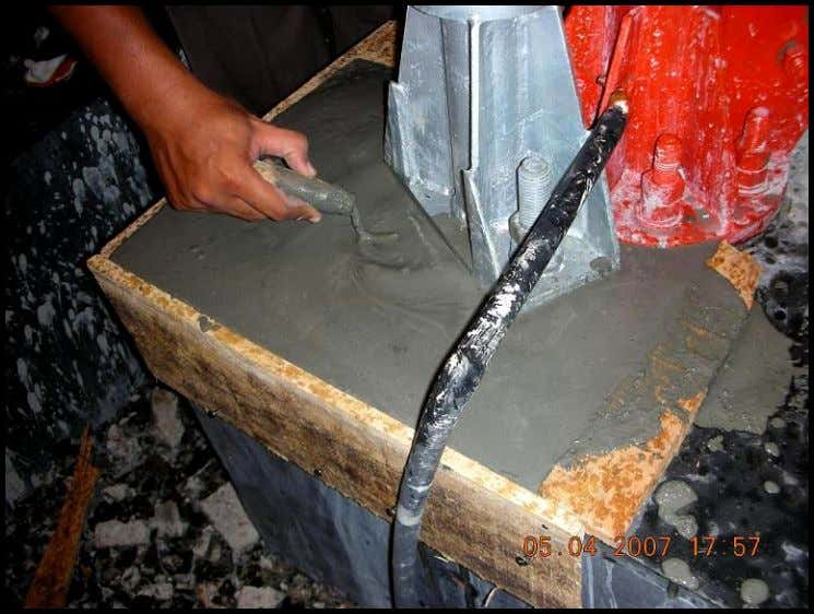 Picture 8. Pour Proses of grout material Picture 9. A spoonlike tools utilization to ensure the