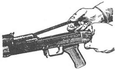 4) Remove the recoil mechanism. Holding the rifle in the left hand by the small