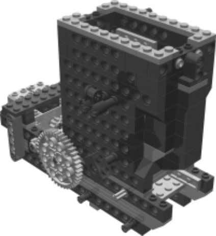 Robot 7 • The DominoBot The Loader The loader sub-assembly delivers a domino from the stack