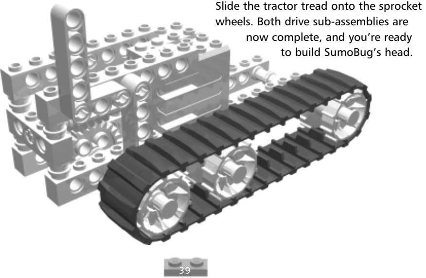Slide the tractor tread onto the sprocket wheels. Both drive sub-assemblies are now complete, and