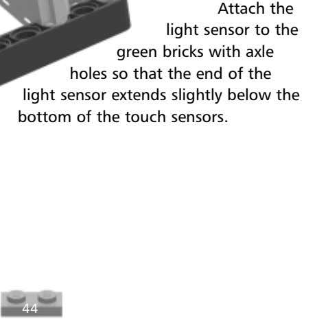 Attach the light sensor to the green bricks with axle holes so that the end