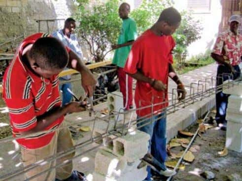and the Haitian Project, go to www.haitianproject.org. S Volunteers help repair the Louverture Cleary School near