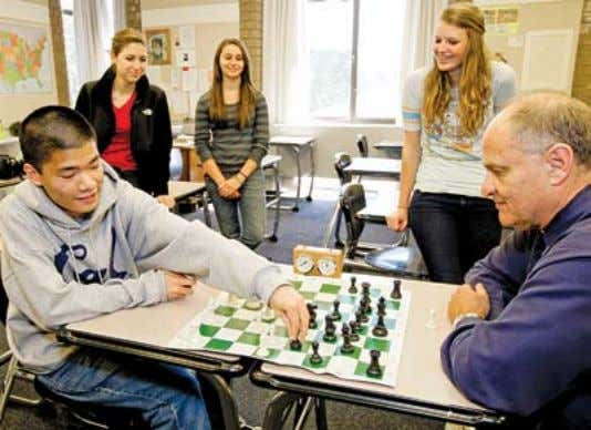 the moderator of the Chess Club, while students looked on. SI SeNIoR MICHAel lIN HAS NeW