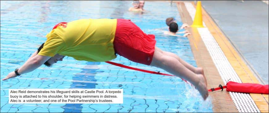 Alec Reid demonstrates his lifeguard skills at Castle Pool. A torpedo buoy is attached to