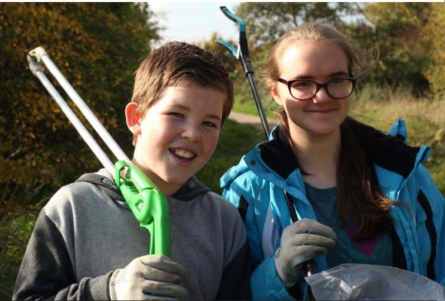 Green clean-up Andrew Johnson (11) and Natasha Hall (14) armed with litter pickers and heavy-duty bin