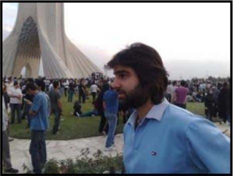 A new picture shows slain student Amir Javadi Far is a gathering in Azadi Square