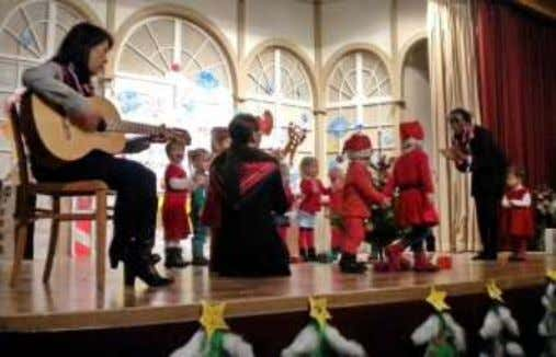 performing on stage singing and dancing. Even brought joy to the grandparents present inside the auditorium.