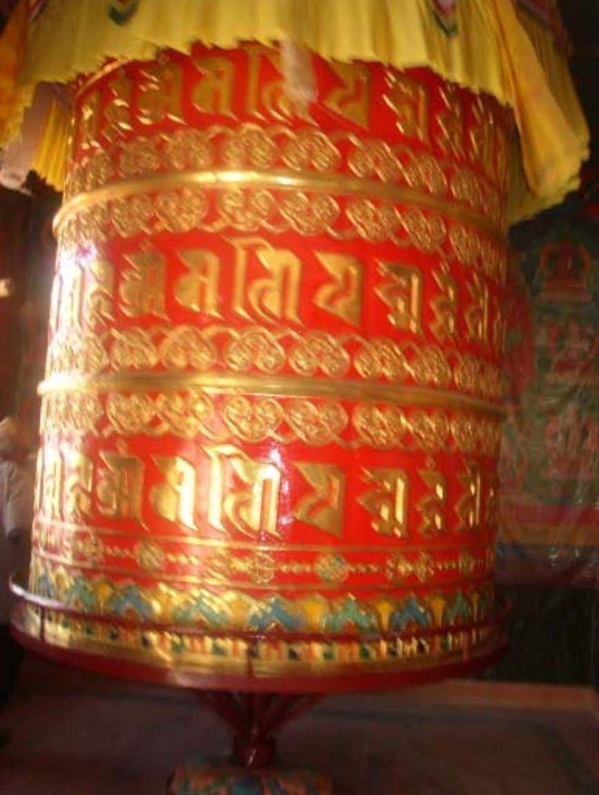 A Large Prayer wheel inscribed with the mantra of Avalokitesvara