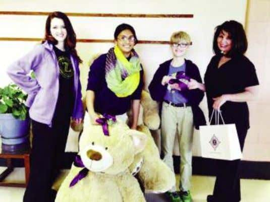 Z-team members, Mary Foret and Stephanie Decoteau, deliv- ered teddy bears along with $100 to each