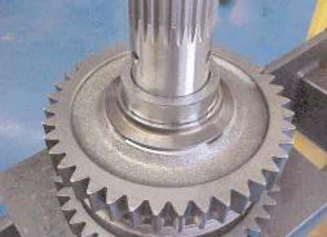 gear onto the shaft and into the reverse gear flange . 13. Take the heated mainshaft