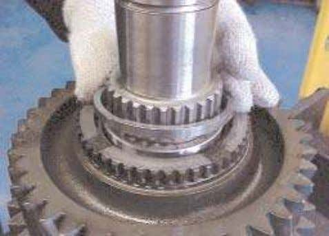 15. Install the bearing spacer ring into the gear and against the bearing. 16. Install