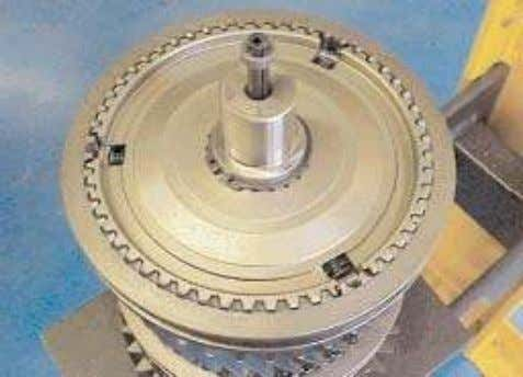 mainshaft. 31. Check the gear end float using feeler gauges. 32. Assemble the three springs and