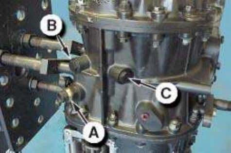 9. Remove the reverse lamp switch (A). Remove the neutral switch (B) and range indicator
