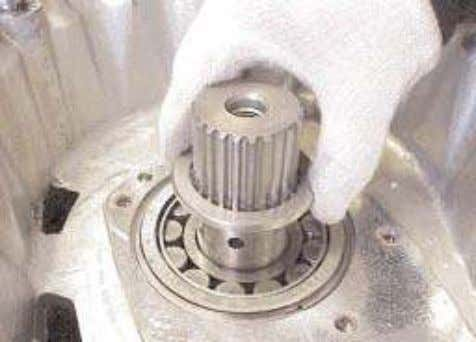 gear and bearings and two thrust washers from the case. 20. Remove the mainshaft bearing thrust