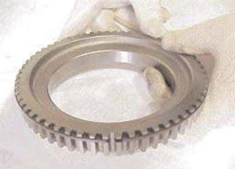 16. If necessary remove the special snap ring from the synchronizer flange. 17. Remove four