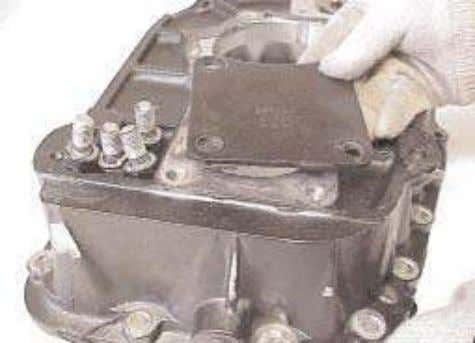 25. Remove the rear PTO cover plate from the rear of the rear case. Unscrew
